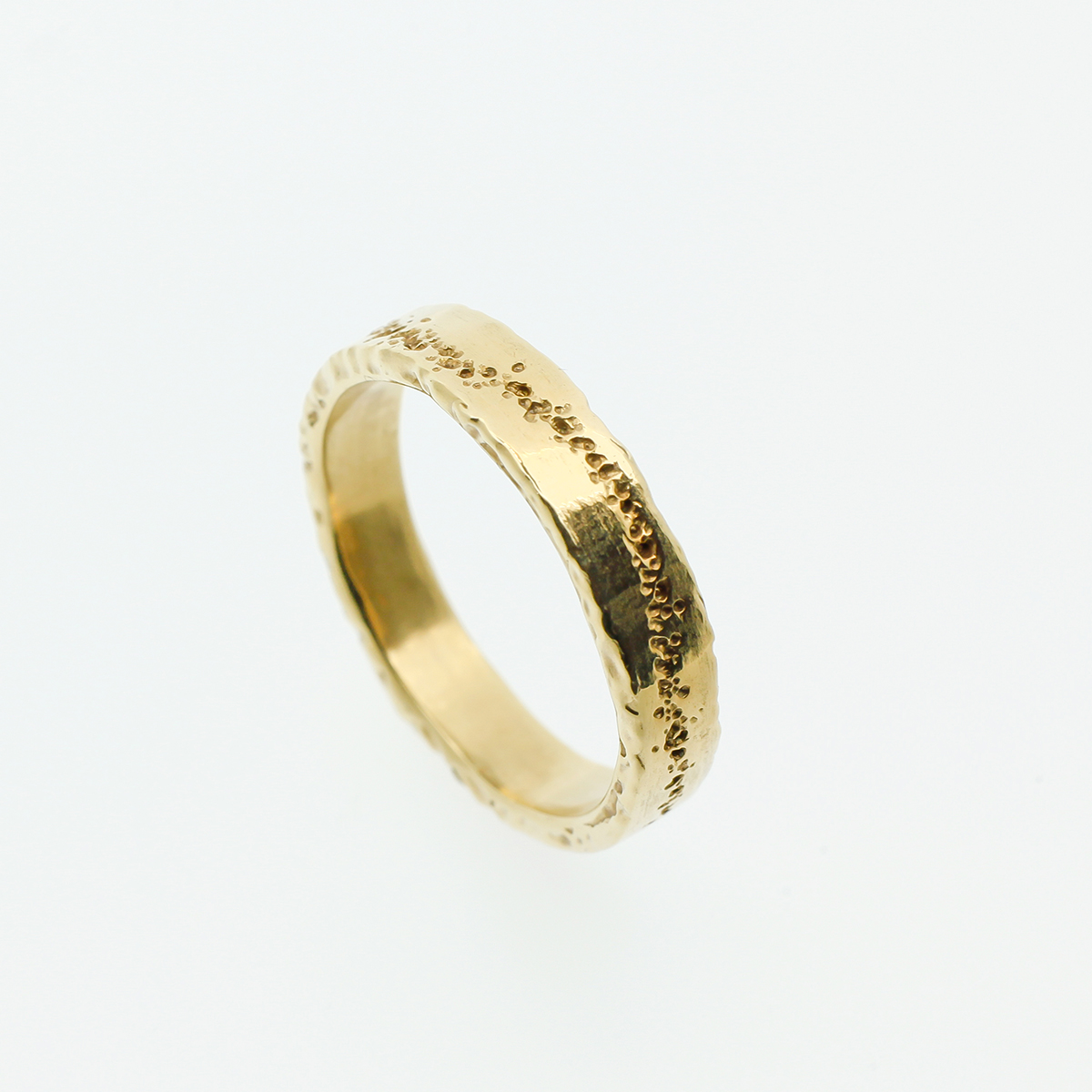 Golden wedding ring with original line in the band