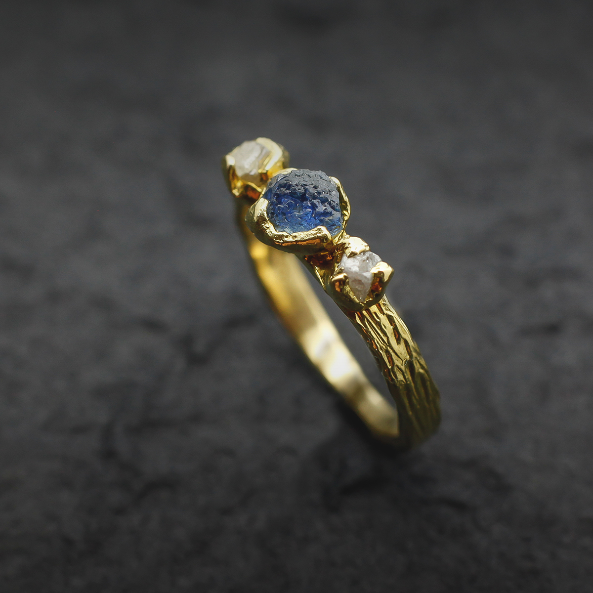 yellow gold ring with sapphire and diamond