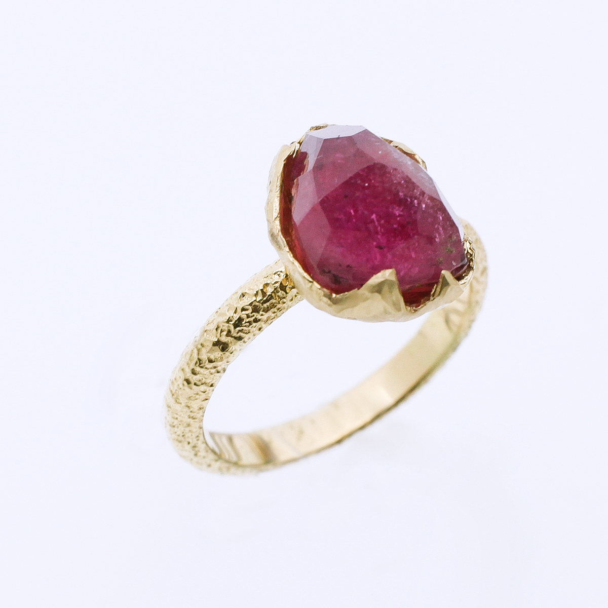 Yellow gold engagement ring with a pink tourmaline.