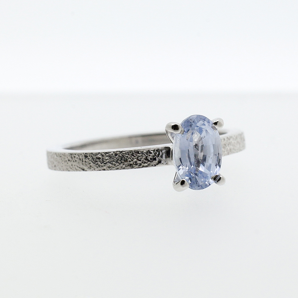 Wite gold ring with light blue sapphire